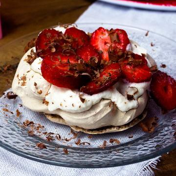 What should you do with leftover egg whites? Make this #chocolate #pavlova that is topped with #strawberries and whipped Cream. It's a perfect dessert for any special occasion!