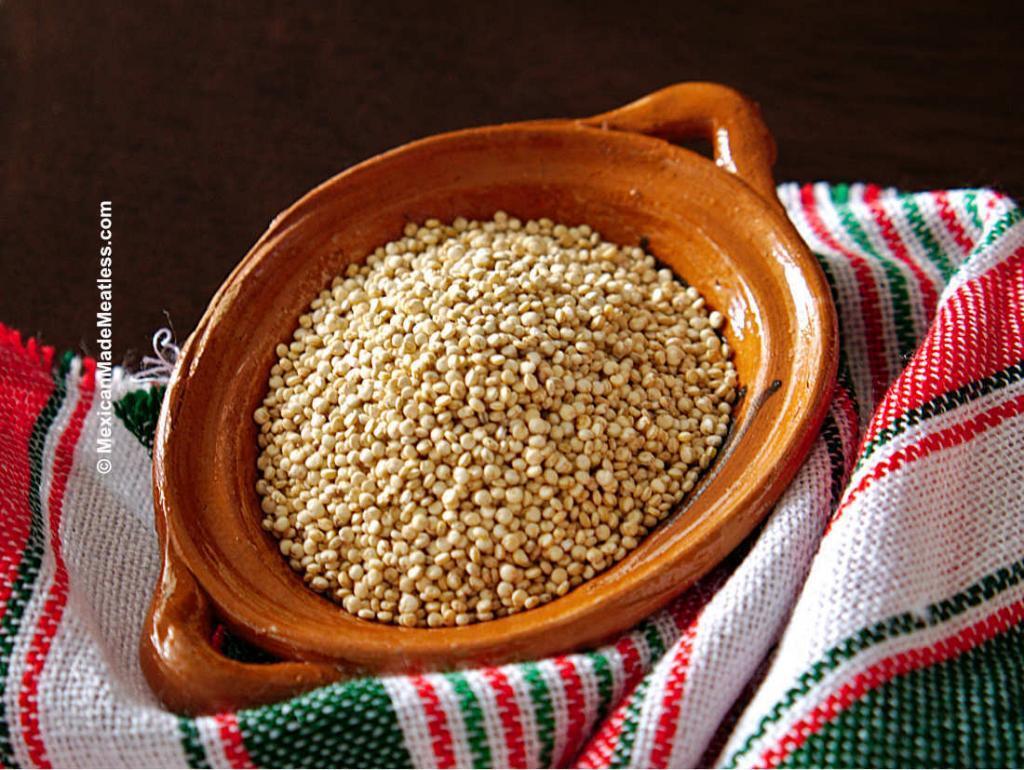 A small bowl of raw white quinoa